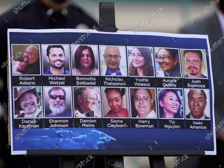 Photos of the 14 victims killed in a 2015 terror attack in San Bernardino, Calif., are displayed outside federal court in Riverside, Calif., . Enrique Marquez Jr. was sentenced to 20 years in prison Friday for supplying the rifles used by his friend Syed Rizwan Farook and Farook's wife to open fire on a meeting and holiday gathering of San Bernardino County employees who worked with Farook. After killing 14 people and wounding 22, Farook and his wife were killed in a gunbattle with authorities