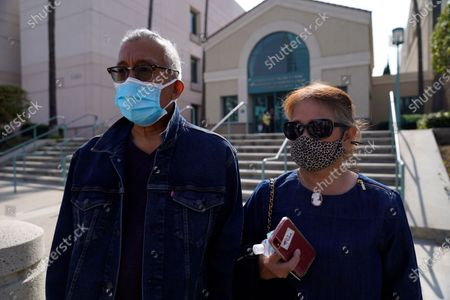 Hilario Venoya and his wife, Margarita talk to the media about his son, Hilario Venoya III, a survivor of the 2015 San Bernardino terror attack but was injured during a shooting, outside federal court in Riverside, Calif., . Enrique Marquez Jr. was sentenced to 20 years in prison Friday for supplying the rifles used by his friend Syed Rizwan Farook and Farook's wife to open fire on a gathering of Farook's co-workers from San Bernardino County nearly five years ago. After killing 14 people and wounding 22, Farook and his wife were killed in a gun battle with authorities