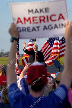 Supporters cheer as Vice President Mike Pence departs a campaign rally at Allegheny County Airport in West Mifflin, Pa