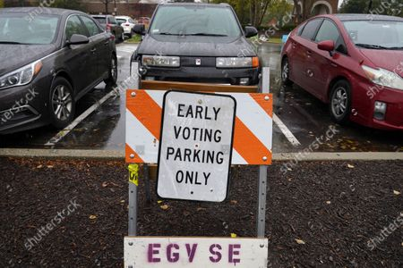 An early voting parking only sign is displayed at Elk Grove Village Hall parking lot during early voting in Elk Grove Village, Ill