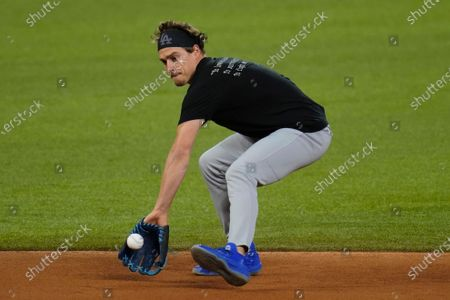 Los Angeles Dodgers second baseman Enrique Hernandez warms up during batting practice before Game 3 of the baseball World Series against the Tampa Bay Rays, in Arlington, Texas. Ray beat the Dodgers 6-4