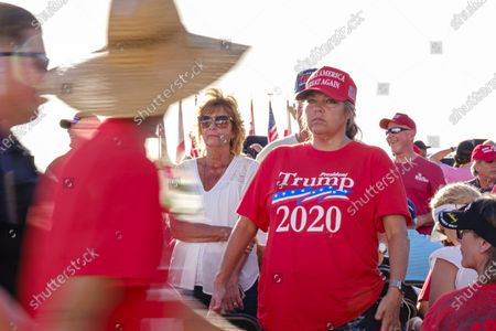 Trump supporters wait for US President Donald J. Trump to speak at a campaign rally in Pensacola, Florida, USA, on 23 October 2020. The United States will hold its presidential election on 03 November.