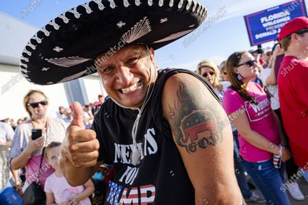A man wearing a 'Mexicans for Trump 2020' shirt shows of his G.O.P. tattoo while waiting for US President Donald J. Trump to speak at a campaign rally in Pensacola, Florida, USA, on 23 October 2020. The United States will hold its presidential election on 03 November.