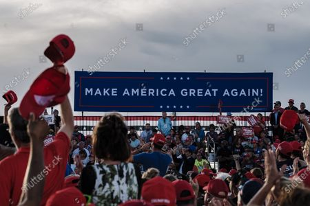 Crowds cheer as they wait for US President Donald J. Trump to speak at a campaign rally in Pensacola, Florida, USA, on 23 October 2020. The United States will hold its presidential election on 03 November.