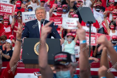 US President Donald J. Trump speaks during his Make America Great Again Rally at the Villages Polo Club in the Villages, Florida, USA, 23 October 2020. The United States will hold its presidential election on 03 November.