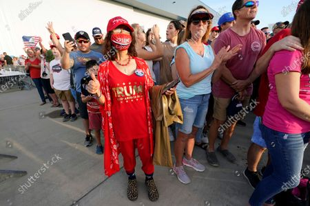 Stock fotografie na téma Supporters chant 'four more years' before President Donald Trump arrives to speak at a campaign rally in Pensacola, Fla