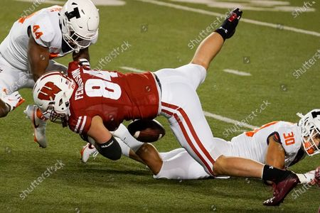 Stock Picture of Wisconsin's Jake Ferguson fumbles the ball during the first half of an NCAA college football game against Illinois, in Madison, Wis. Illinois recovered the fumble and scored a touchdown on the play