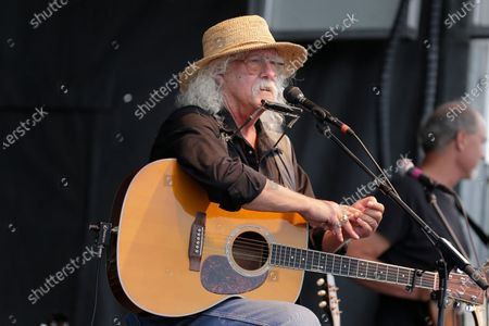 Arlo Guthrie talks during a concert at a Woodstock 50th anniversary event in Bethel, N.Y.In lengthy posts on his Facebook page and website, the 73-year-old folksinger announced, he is retiring from performance immediately. He's canceled numerous shows next year and says he won't book any new ones