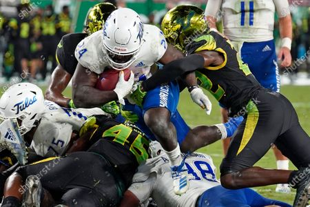 Tulsa running back Corey Taylor II (24) gets past South Florida defensive back Mekhi LaPointe (22) to score a touchdown during the second half of an NCAA college football game, in Tampa, Fla