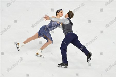 Caroline Green and Michael Parsons of the United States, compete during ice dance rhythm dance program in the International Skating Union Grand Prix of Figure Skating Series, in Las Vegas