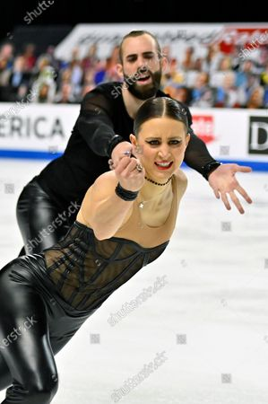 Ashley Cain-Gribble and Timothy Leduc of the United States, compete during the pairs short program in the International Skating Union Grand Prix of Figure Skating Series, in Las Vegas