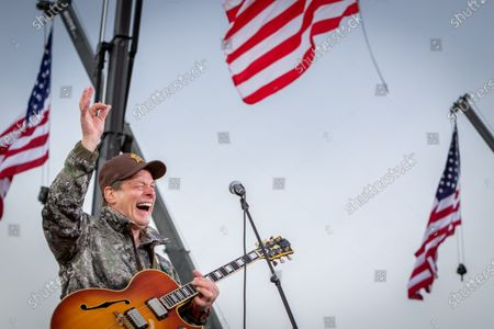 Musical artist Ted Nugent plays the American national anthem before U.S. President Donald Trump speaks at an outdoor rally at Muskegon County Airport in Norton Shores, Michigan