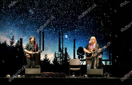 Amy Ray and Emily Saliers with the Indigo Girls perform during the Live From the Drive-In concert series at the Ameris Bank Amphitheatre, in Atlanta