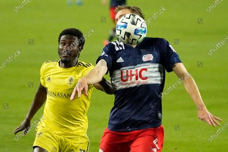 Nashville SC forward Abu Danladi left, and New England Revolution defender Henry Kessler chase down the ball during the first half of an MLS soccer match, in Nashville, Tenn