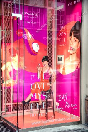 """Stock Image of Window display advertisement at the Harmony Sex Shop in London's Oxford Street for Pop star Lily Allen's """"Liberty"""" sex toy collaboration with Womanizer."""