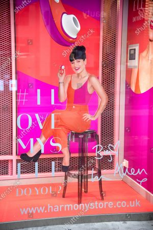 """Window display advertisement at the Harmony Sex Shop in London's Oxford Street for Pop star Lily Allen's """"Liberty"""" sex toy collaboration with Womanizer."""