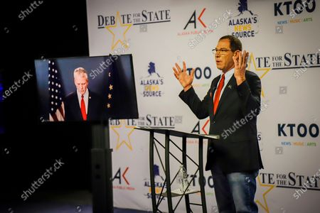 Al Gross, right, an independent in Alaska's U.S. Senate race, gestures during a debate with Republican U.S. Sen. Dan Sullivan, in Anchorage, Alaska. Sullivan participated remotely, as the Senate prepares to vote on President Donald Trump's Supreme Court nominee in Washington, D.C