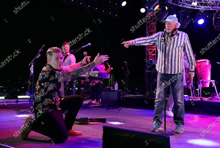Mike Love of The Beach Boys, right, performs with guest member Mark McGrath during the Concerts In Your Car series at the Ventura County Fairgrounds, in Ventura, Calif