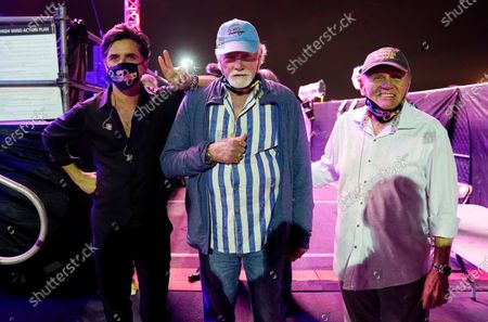 Beach Boys members Mike Love, center, and Bruce Johnston, right, pose with guest member John Stamos before their performance at the Concerts In Your Car series at the Ventura County Fairgrounds, in Ventura, Calif