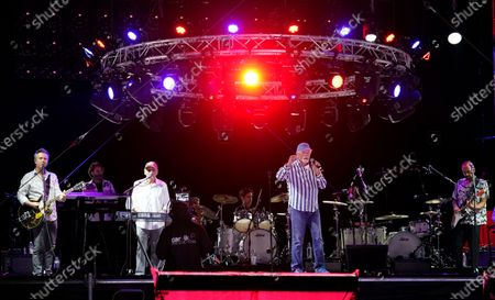 Mike Love, center, and Bruce Johnston, third from left, of The Beach Boys perform with their band during the Concerts In Your Car series at the Ventura County Fairgrounds, in Ventura, Calif