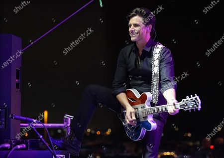 John Stamos performs with The Beach Boys during their performance at the Concerts In Your Car series at the Ventura County Fairgrounds, in Ventura, Calif