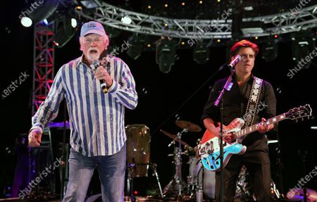 Mike Love of The Beach Boys, right, performs alongside guest member John Stamos during the Concerts In Your Car series at the Ventura County Fairgrounds, in Ventura, Calif