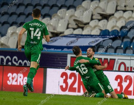 Jordan Storey (14) of Preston North End joins Ryan Ledson (18) of Preston North End to celebrate with Alan Browne (8) of Preston North End after scoring the winner against Huddersfield in minute 53 for 1-2; 24th October 2020 The John Smiths Stadium, Huddersfield, Yorkshire, England; English Football League Championship Football, Huddersfield Town versus Preston North End.