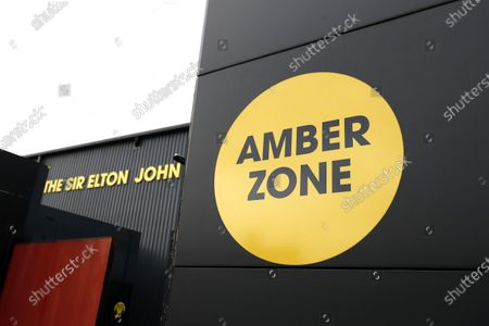 Stock Image of Amber Zone entrance sign outside the Sir Elton John Stand; Vicarage Road, Watford, Hertfordshire, England; English Football League Championship Football, Watford versus AFC Bournemouth.