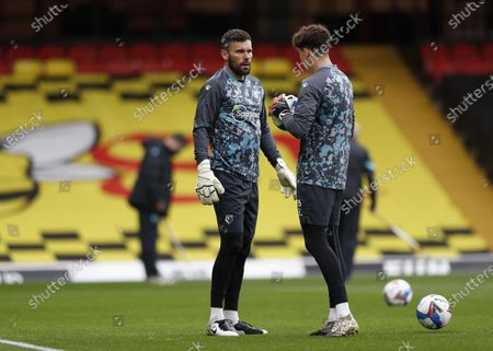 Stock Picture of Goalkeeper Ben Foster of Watford talking to Goalkeeper Adam Parkes of Watford during pre match warm up; Vicarage Road, Watford, Hertfordshire, England; English Football League Championship Football, Watford versus AFC Bournemouth.