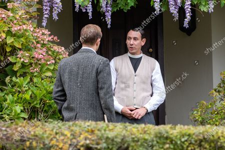 Stock Photo of Al Weaver (right) and Oliver Dimsdale filming the ITV drama Grantchester in the village of Grantchester near Cambridge on Friday morning. TV heartthrob Tom Brittney was seen wearing a leather jacket and riding a motorbike as he filmed the latest series of ITVÕs Grantchester yesterday (Thurs).The actor, who plays Reverend Will Davenport, was spotted whizzing around the streets of picturesque Grantchester in Cambridgeshire on his bike.He was later seen talking to The Think Of It actress Rebecca Front, who is one of a number of guest stars in this series of the 1950s show.Brittney was seen sheltering under a large umbrella in between takes, whilst Rebecca, who was dressed in a smart winter coat and hat, appeared to be practising her lines.