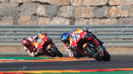 Spanish MotoGP rider Alex Marquez (R) of Repsol Honda team, takes a bend followed by his teammate German Stefan Bradl (L) during the practice session of the Motorcycling Grand Prix of Teruel at the Motorland Alcaniz racetrack in Alcaniz, Teruel, Spain, 24 October 2020. The Motorcycling Grand Prix of Teruel will be held on 25 October 2020.