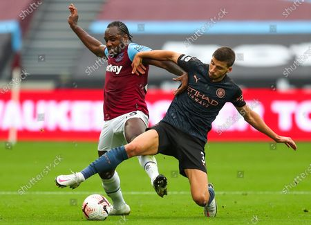 Michail Antonio (L) of West Ham in action against Ruben Dias (R) of Manchester City during the English Premier League match between West Ham United and Manchester City in London, Britain, 24 October 2020.