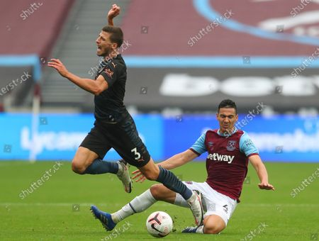 Fabian Balbuena (R) of West Ham in action against Ruben Dias (L) of Manchester City during the English Premier League match between West Ham United and Manchester City in London, Britain, 24 October 2020.