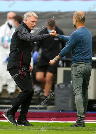 West Ham's Manager David Moyes (L) greets  Manchester City manager Pep Guardiola (R) after the English Premier League match between West Ham United and Manchester City in London, Britain, 24 October 2020.