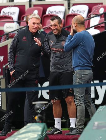 West Ham's Manager David Moyes (L) talks with Manchester City manager Pep Guardiola (R) prior to the English Premier League match between West Ham United and Manchester City in London, Britain, 24 October 2020.