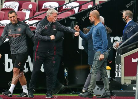 West Ham's Manager David Moyes (2-L) and Manchester City manager Pep Guardiola (R) prior to the English Premier League match between West Ham United and Manchester City in London, Britain, 24 October 2020.