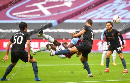 Michail Antonio (C) of West Ham scores the opening goal against Manchester City's Ruben Dias (2-R) during the English Premier League match between West Ham United and Manchester City in London, Britain, 24 October 2020.