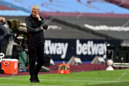 West Ham's manager David Moyes stands by the bench the English Premier League soccer match between West Ham and Manchester City, at the London Olympic Stadium