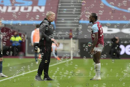 David Moyes Manager of West Ham United with Michail Antonio of West Ham United during the West Ham vs Manchester City Premier League Football held behind closed doors