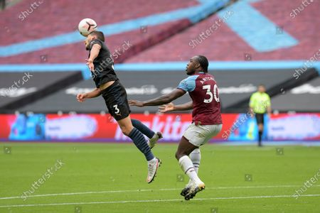Michail Antonio of West Ham United and Ruben Dias of Manchester City during the West Ham vs Manchester City Premier League Football held behind closed doors