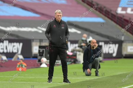 David Moyes Manager of West Ham United and Pep Guardiola Manager of Manchester City during the West Ham vs Manchester City Premier League Football held behind closed doors