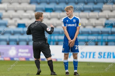 John Busby (Referee) talking and giving instruction to Scott Robinson, Midfielder with Gillingham (20) before a free kick awarded to Glenn Whelan, Captain & Midfielder with Fleetwood Town FC (6) during the EFL Sky Bet League 1 match between Gillingham and Fleetwood Town at the MEMS Priestfield Stadium, Gillingham