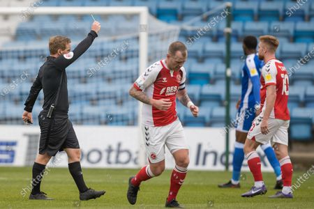 John Busby (Referee) awarded a yellow card to Scott Robinson, Midfielder with Gillingham (20) during the EFL Sky Bet League 1 match between Gillingham and Fleetwood Town at the MEMS Priestfield Stadium, Gillingham