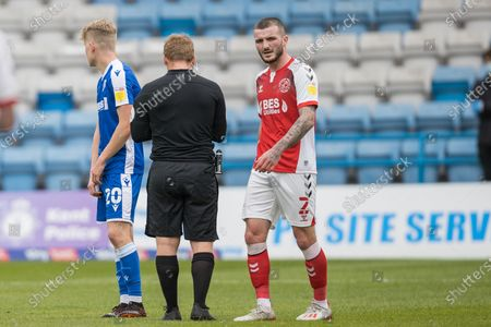 Thomas Edwards, Defender with Fleetwood Town FC (2) waiting for instruction from John Busby (Referee) for the free kick following a foul from Scott Robinson, Midfielder with Gillingham (20) during the EFL Sky Bet League 1 match between Gillingham and Fleetwood Town at the MEMS Priestfield Stadium, Gillingham