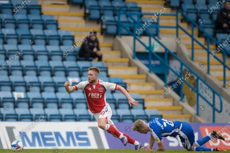Callum Camps, Midfielder with Fleetwood Town FC (10) with Scott Robinson, Midfielder with Gillingham (20) injured following his tackle during the EFL Sky Bet League 1 match between Gillingham and Fleetwood Town at the MEMS Priestfield Stadium, Gillingham