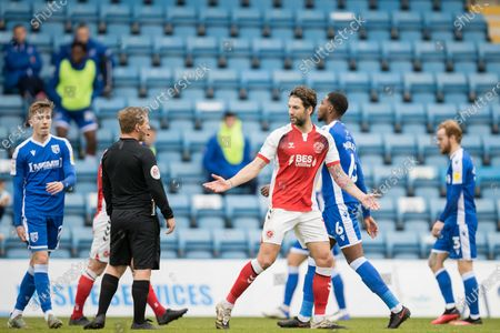 Charlie Mulgrew, Defender with Fleetwood Town FC (14) raising his arms as he walks past John Busby (Referee) during the EFL Sky Bet League 1 match between Gillingham and Fleetwood Town at the MEMS Priestfield Stadium, Gillingham