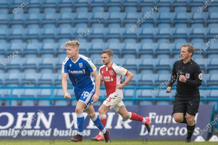 Stock Photo of Scott Robinson, Midfielder with Gillingham (20), Sam Finley, Midfielder with Fleetwood Town FC (23) and John Busby (Referee) during the EFL Sky Bet League 1 match between Gillingham and Fleetwood Town at the MEMS Priestfield Stadium, Gillingham