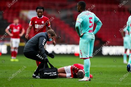 Andreas Weimann of Bristol City receives treatment