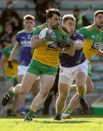 Kerry vs Donegal. Kerry's Stephen O'Brien and Paddy McGrath of Donegal