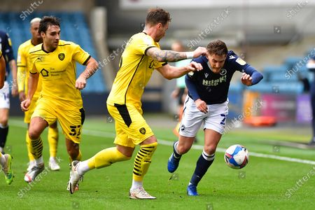 Matty James, Michael, Sollbauer, Connor Mahoney during the EFL Sky Bet Championship match between Millwall and Barnsley at The Den, London